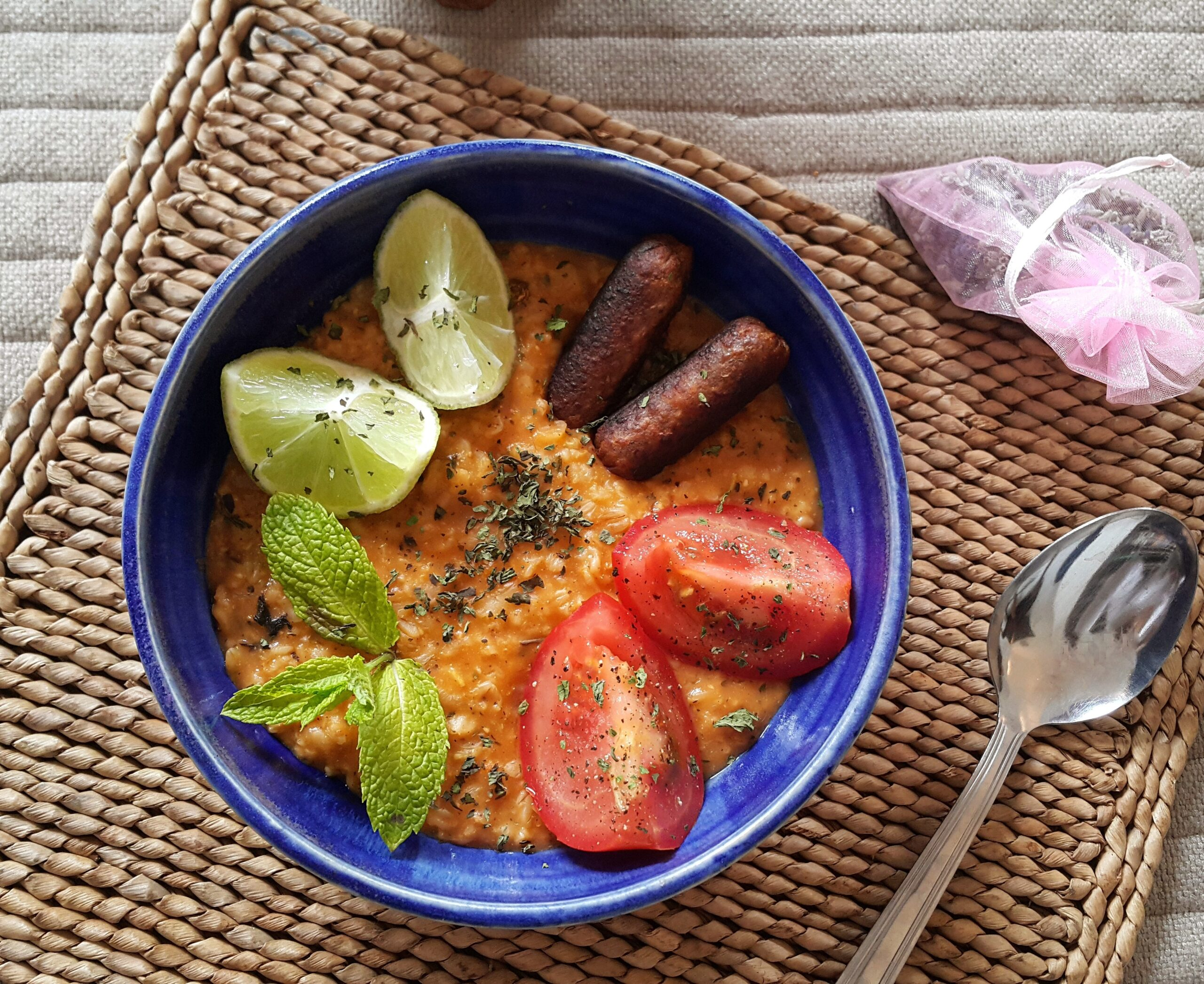 Savory tomato porridge with dried mint and basil